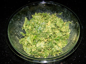 Fresh kale, coated with the topping.